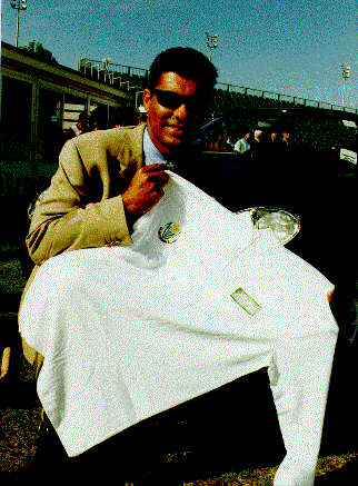 Waqar Younis shows off his new Glamorgan shirt