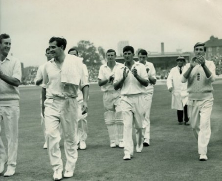 Trueman leads the team off the field