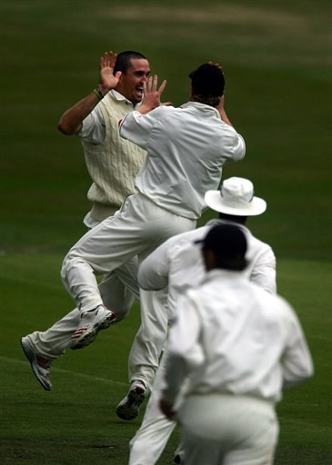 Kevin Pietersen celebrates after getting Salman Butt run out