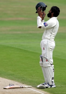 Mohammad Yousuf holds his helmet while celebrating century