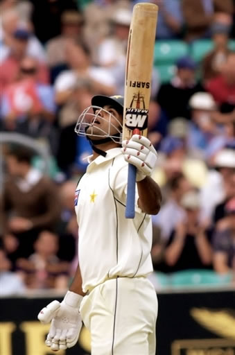 Mohammad Hafeez raises his bat after his 50