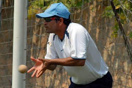 Sachin Tendulkar tries to catch the ball during practice session