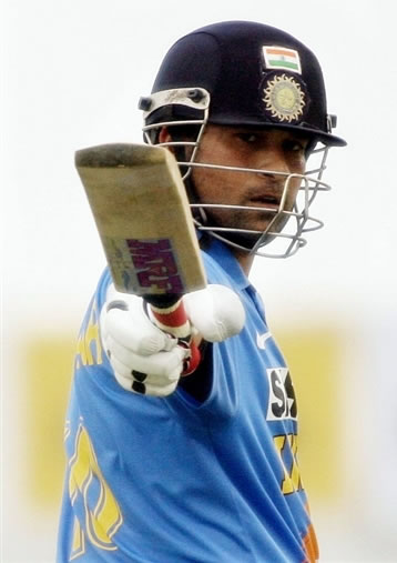 Tendulkar raises his bat after his century
