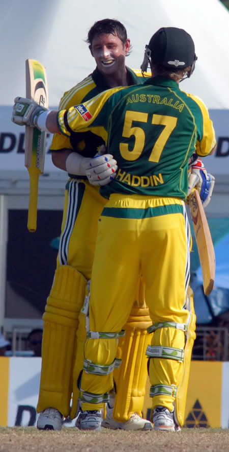 Hussey congratulated by Haddin after his century
