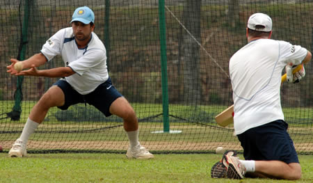 Tendulkar tries to catch the ball