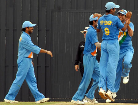 Tendulkar and RP Singh celebrates with teammates after taking a wicket