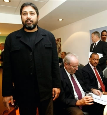 Inzamam-ul-Haq enters the room as Darrell Hair reads his papers during the ICC disciplinary hearing