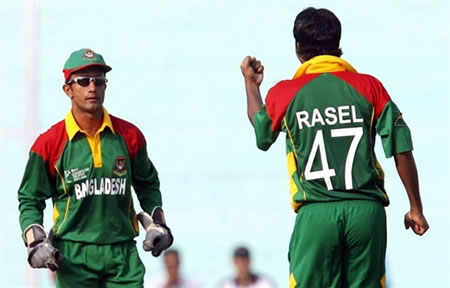 Rasel celebrates with Khaled after taking a wicket