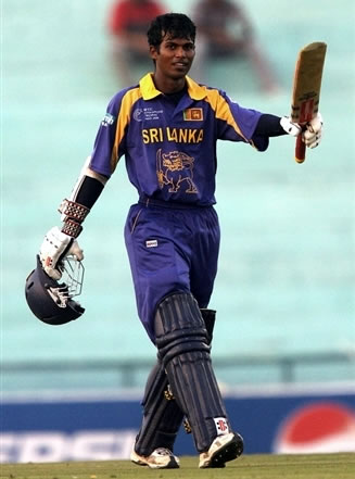 Tharanga raises his bat after his century