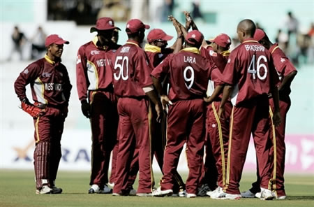 West Indies players celebrate after taking a wicket