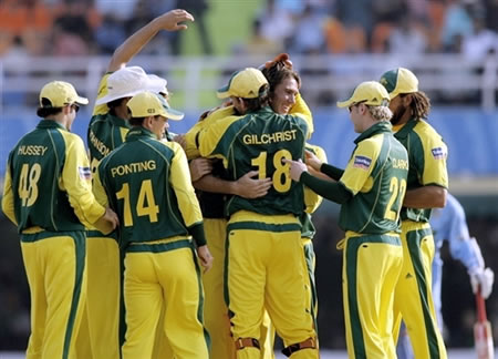 McGrath congratulated by teammates after taking a wicket