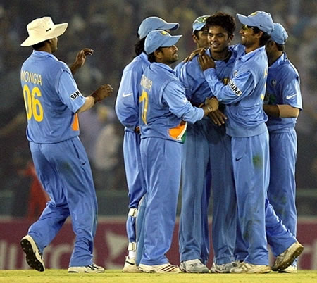 Sreesanth congratulated by teammates after taking a wicket
