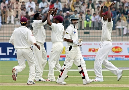 West Indies celebrate the dismissal of Mohammad Hafeez