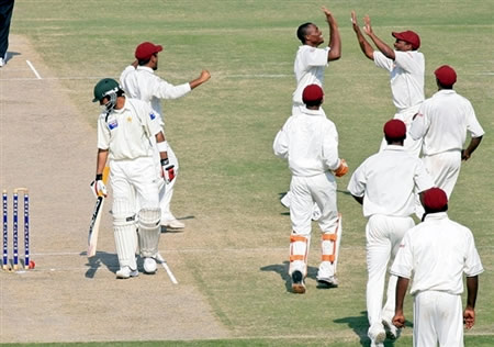 West Indies celebrate the wicket of Shoaib Malik