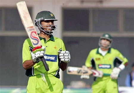 Yasir Hameed waves his bat after fifty