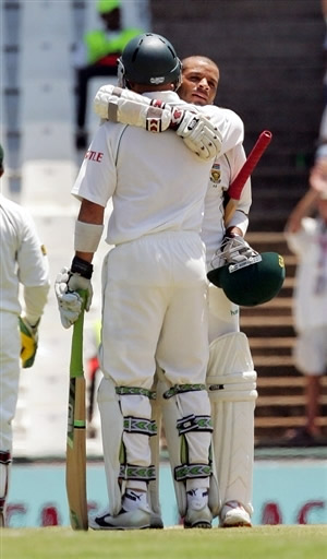 Prince is congratulated by Gibbs after his century