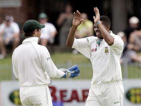 Makhaya Ntini & Mark Boucher celebrate the wicket of Imran Farhat