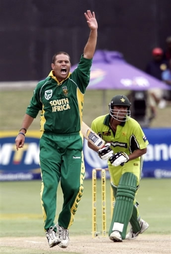 Andrew Hall celebrates the wicket of Younis Khan