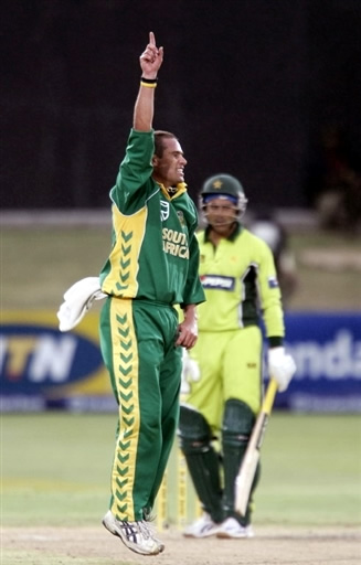 Andrew Hall celebrates the wicket of Razzaq