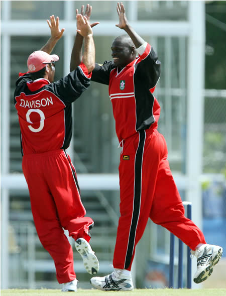 Henry Osinde & John Davison celebrate the wicket of Imran Nazir
