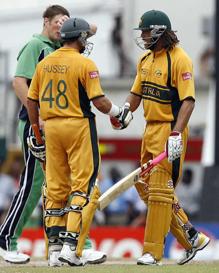 Andrew Symonds congratulates Mike Hussey after victory over Ireland