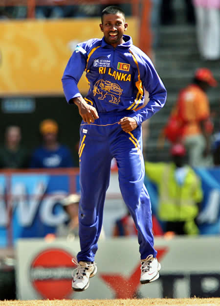 Russel Arnold celebrates the wicket of Gilchrist