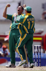 Andre Nel celebrates the wicket of Vaughan