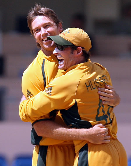 McGrath & Hussey celebrate the wicket of Taylor