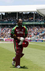 Brian Lara walks off after being run out in his last ODI