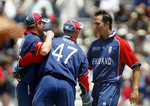 Michael Vaughan celebrates the wicket of Marlon Samuels with his teammates