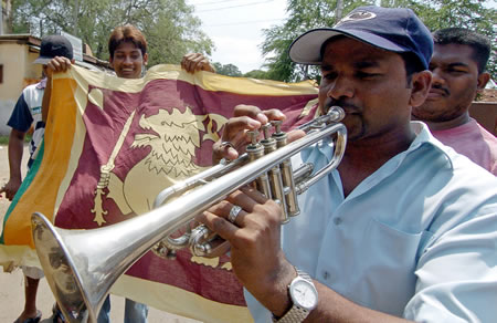 Sri Lankan cricket fans celebrate their team's win in a World Cup 2007 semi-final match against New Zealand, in the streets of Colombo, 25 April 2007