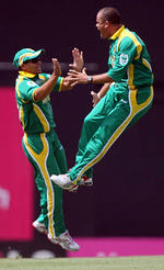 Charl Langeveldt celebrates the wicket of Gilchrist