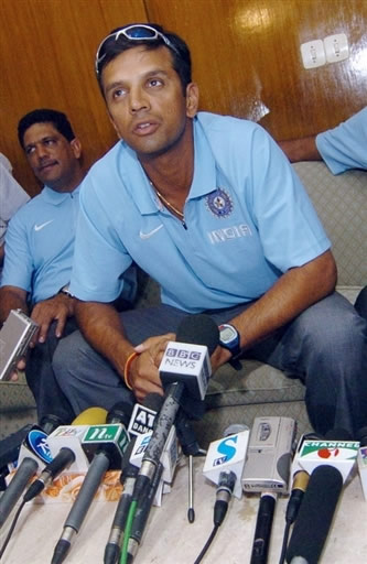 Rahul Dravid talks with journalists upon the team's arrival at the Zia International airport in Dhaka