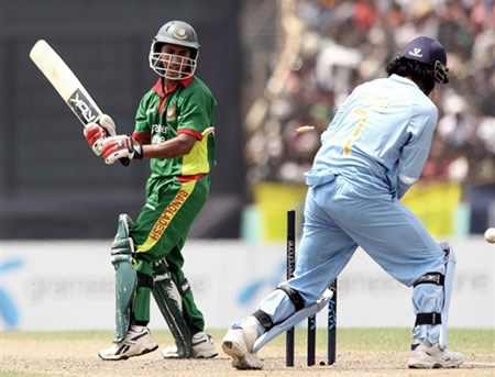 Mohammad Ashraful is bowled by Mongia
