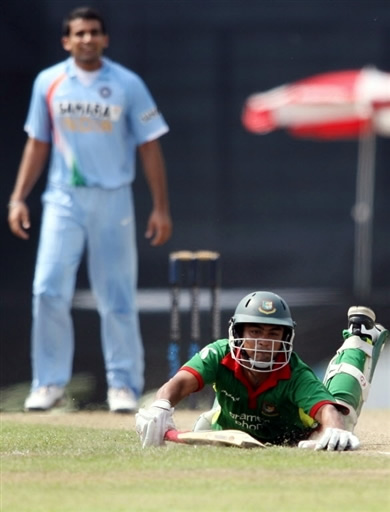 Tamim Iqbal is run out by Chawla