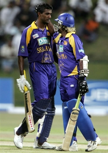 Farveez Maharoof celebrates his fifty with his teammate Malinga