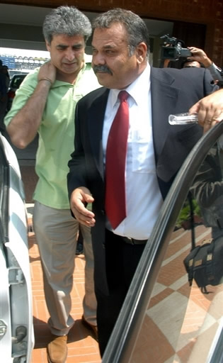 Dav Whatmore leaves the Gaddafi Stadium with PCB Director Operations Zakir Khan after he was interviewed by PCB panel