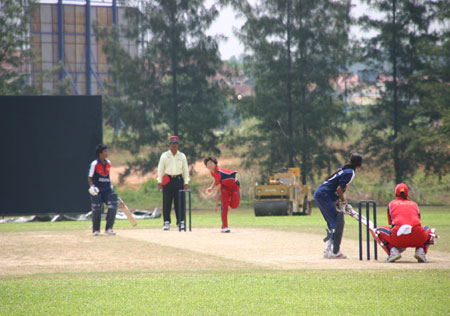 Kaori Iid faces a ball from Nepal bowler Renee Montgomery is non-striker