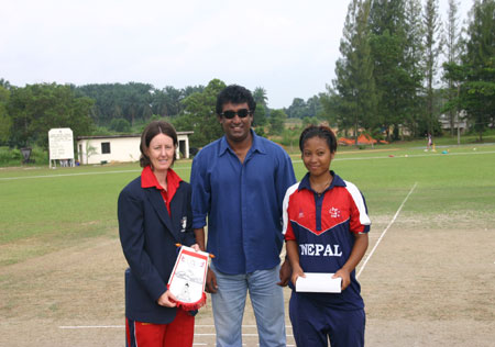 Hong Kong Women's and Nepal Women's Captains with Match referee after the toss