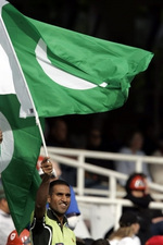 A supporter waves a Pakistani flag in celebration