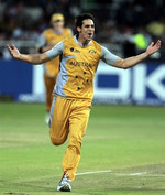 Mitchell Johnson celebrates the wicket of Sehwag
