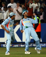 Yuvraj Singh celebrates after taking the catch of Hussey