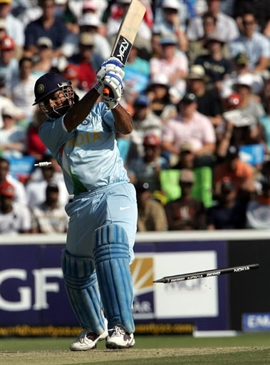 Mahendra Singh Dhoni is bowled by Umar Gul