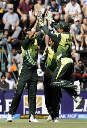 Umar Gul celebrates the wicket of Yuvraj Singh