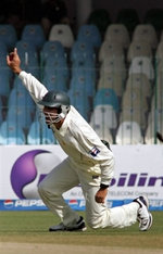 Misbah-ul-Haq celebrates the catch of Andre Nel