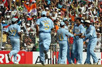 Irfan Pathan celebrates the wicket of Kamran