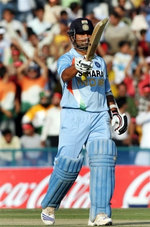 Sachin Tendulkar celebrates his fifty