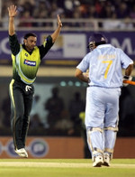 Shoaib Akhtar celebrates the wicket of Dhoni