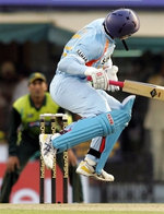Yuvraj Singh avoids a bouncer