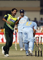 Sohail Tanvir celebrates the wicket of Sachin Tendulkar